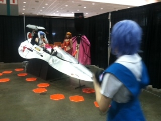 An Evangelion cockpit used as a backdrop for cosplay photography.