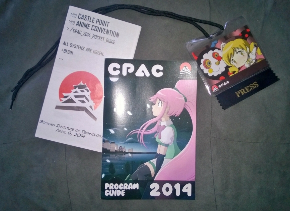 The art for the badges and con guide were fantastic this year!