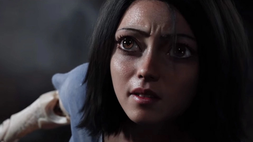 The live-action Alita, with giant eyes, looking up with concern and sweating