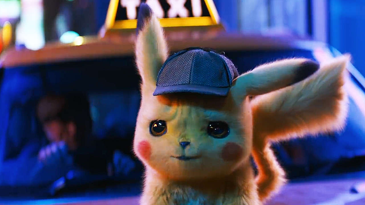Detective Pikachu from the movie looking concerned while standing on top of a car hood.