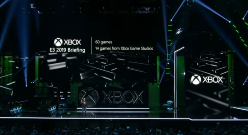 "Xbox E3 press conference with a screen showing the text ""60 games, 14 games from Xbox Game Studios."""