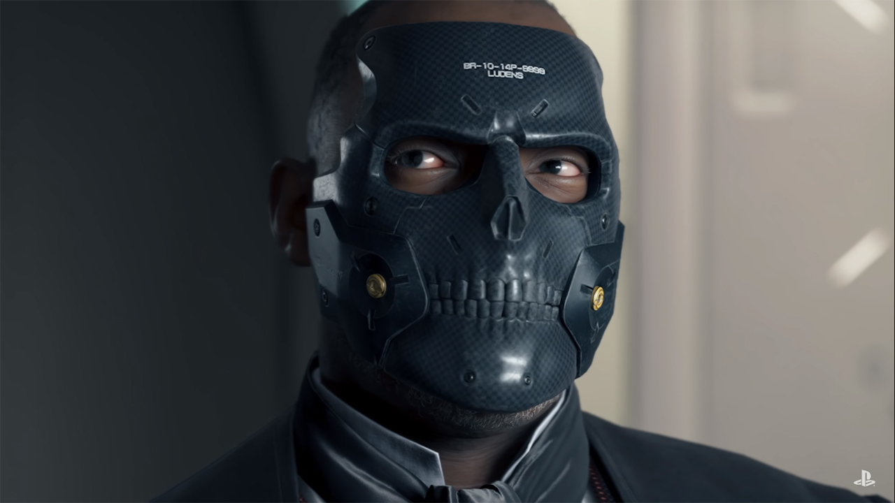 Die-Hardman from Death Stranding. He's a black man wearing a black skull-shaped mask.