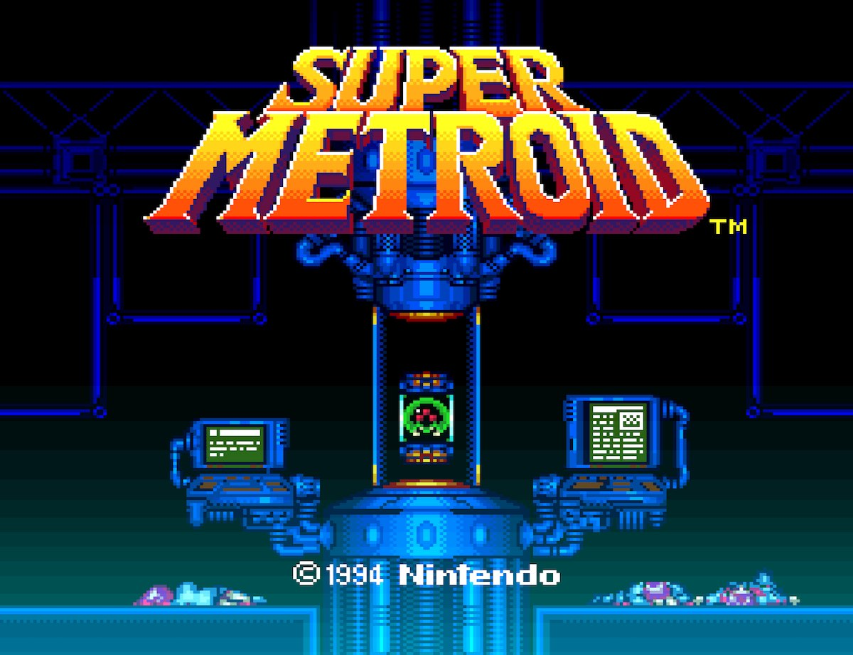 Title screen of Super Metroid. A small Metroid is floating in a tank with computer monitors nearby. Three scientists are dead on the floor.