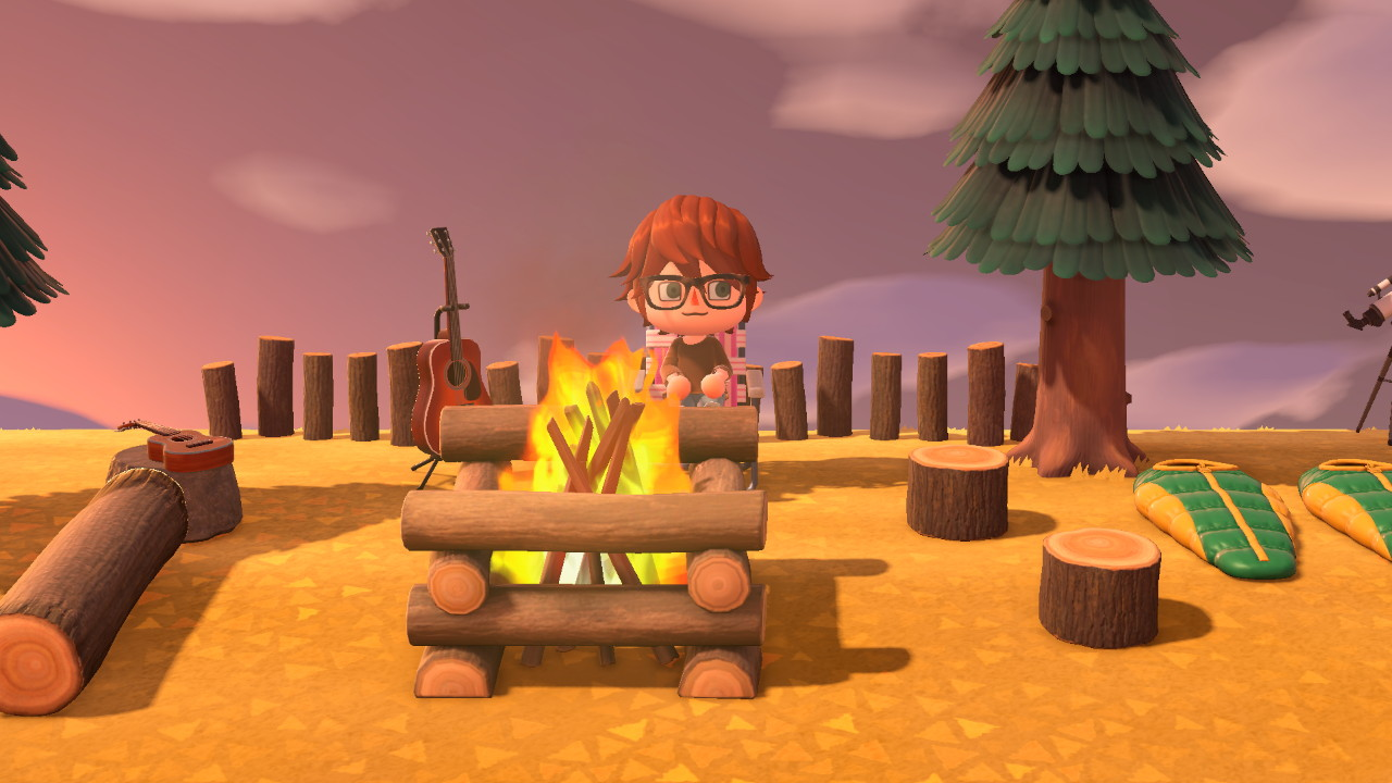 Animal Crossing screenshot of Evan sitting in front of a bonfire.