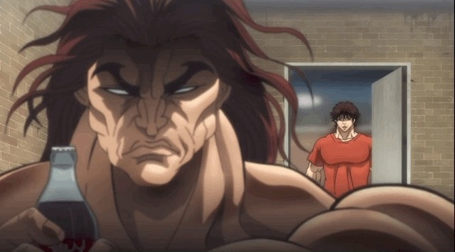 Baki's dad Yujiro holding a coke bottle while Baki stands behind him.