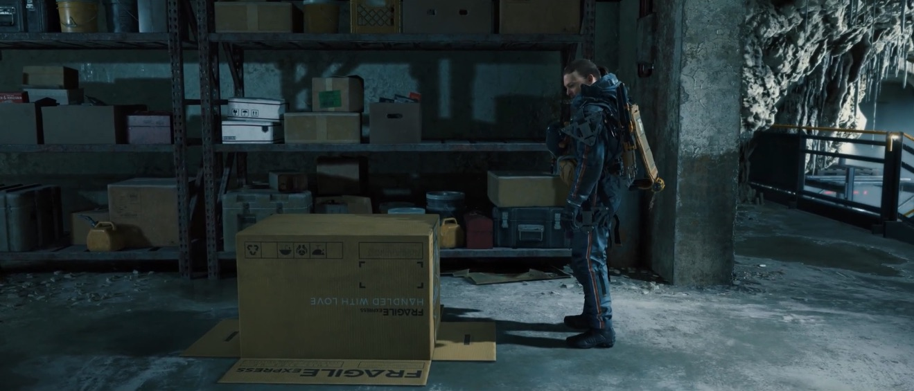 Sam Porter Bridges from Death Stranding standing in front of a cardboard box.