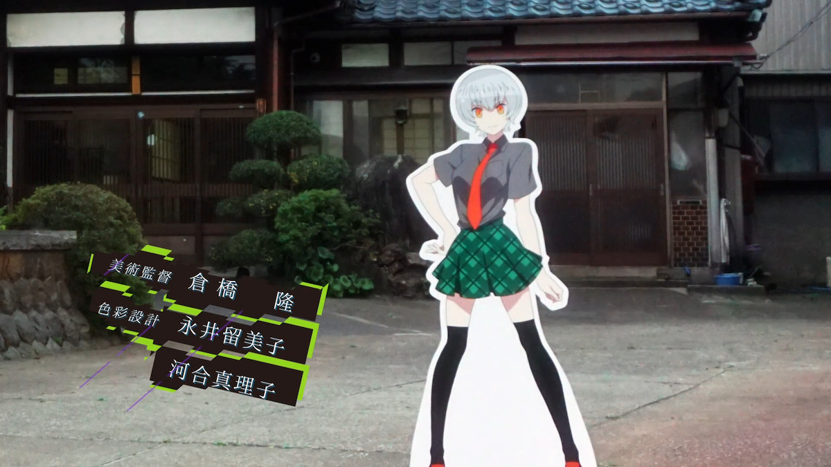 A standee of a character against a live background in Gatchaman Crowds.