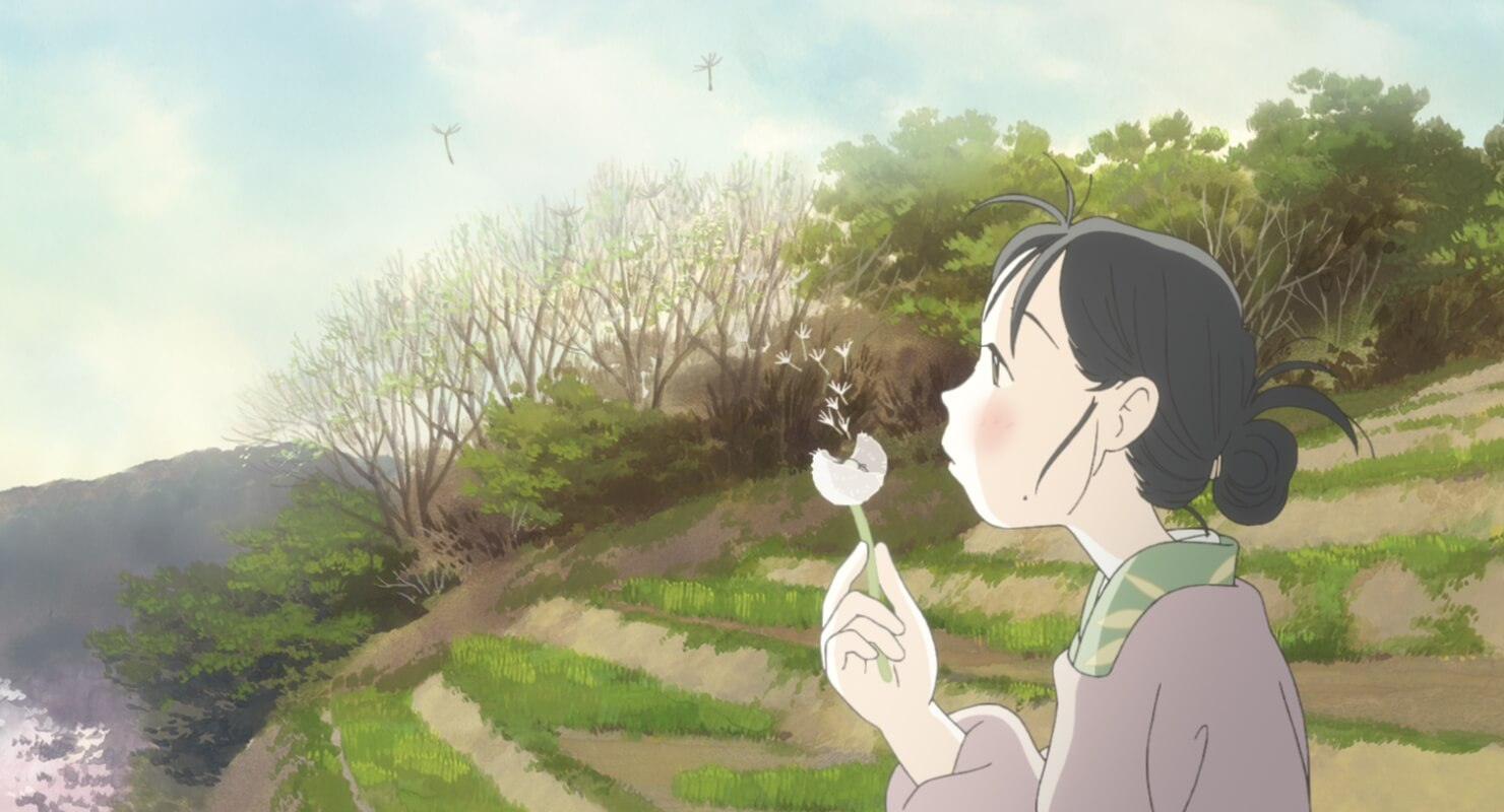 Suzu (the main character of the film) blowing dandelion seeds into the wind.