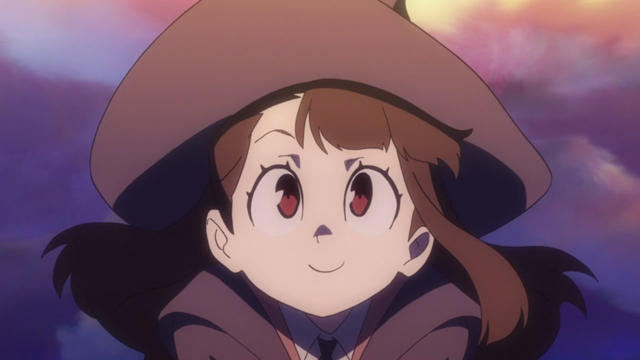 Akko from Little Witch Academia smiling and looking up