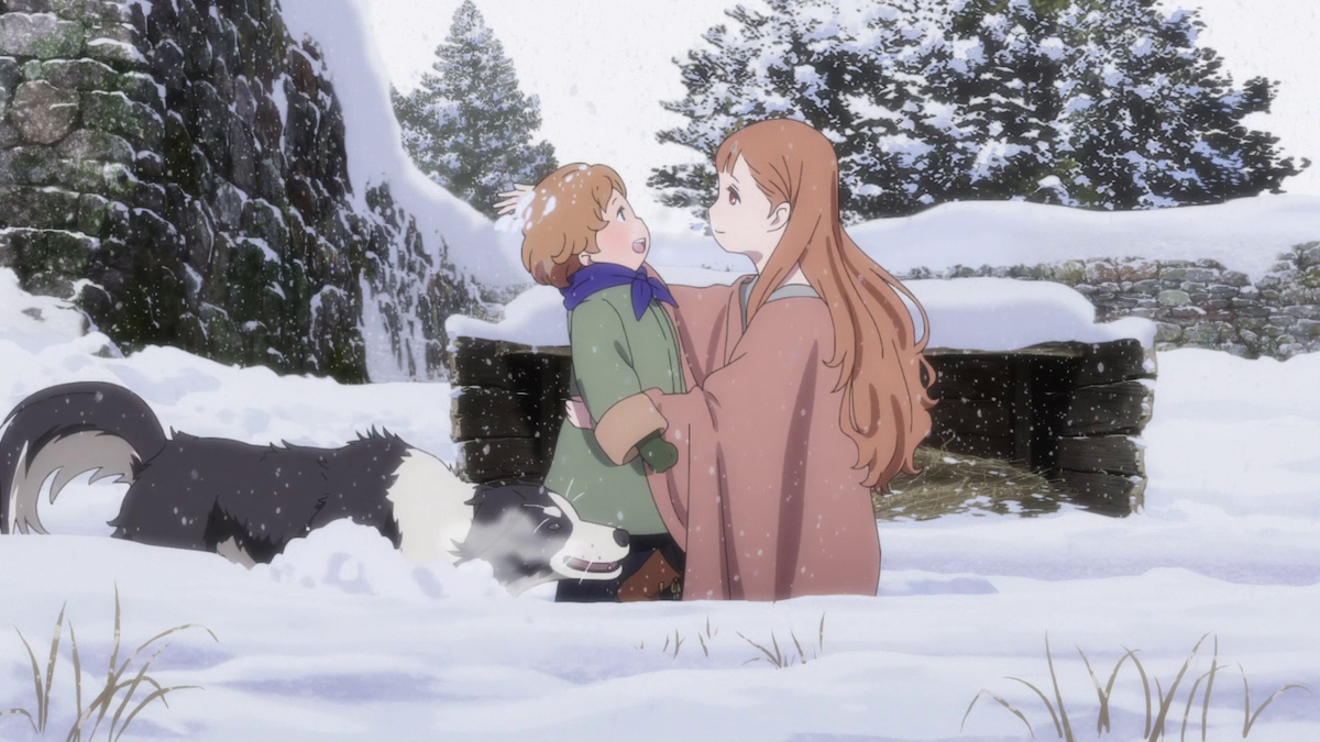 Maquia and her son Arial playing in the snow with their dog