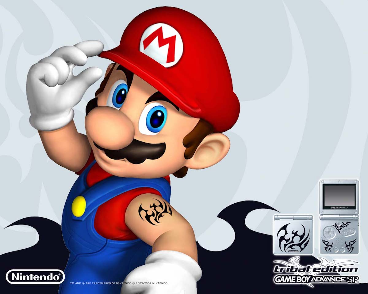 Mario showing off a tribal tattoo on his upper arm.