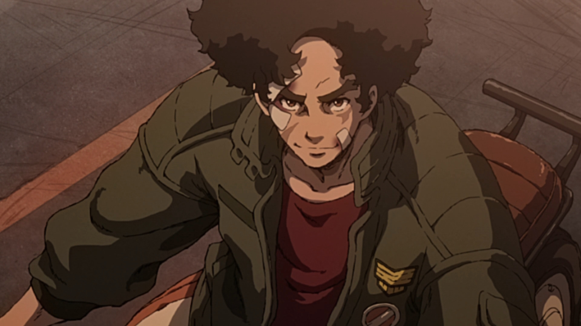 Joe from Megalobox on a motorcycle, smiling.