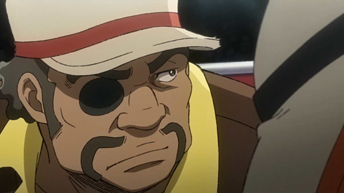 Nanbu frowning and looking to the side. He's wearing a cap and an eyepatch.