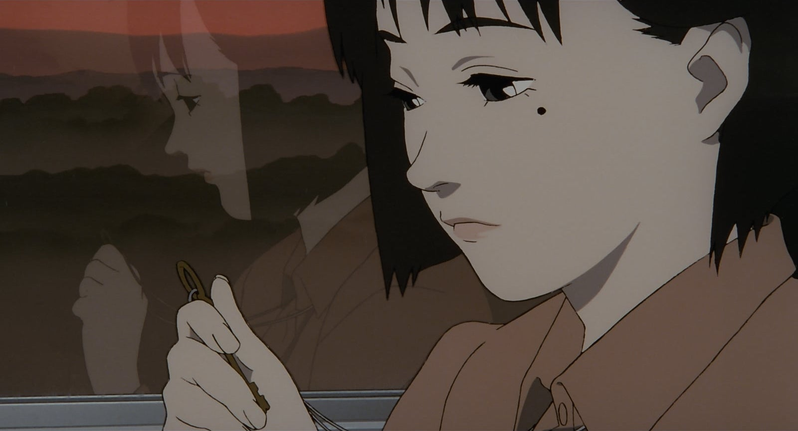 A young Chiyoko looking wistfully at a key in her hand.