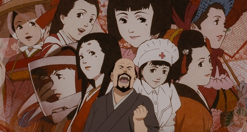 Genya looking excited, standing in front of a collage of all of Chiyoko's major roles.