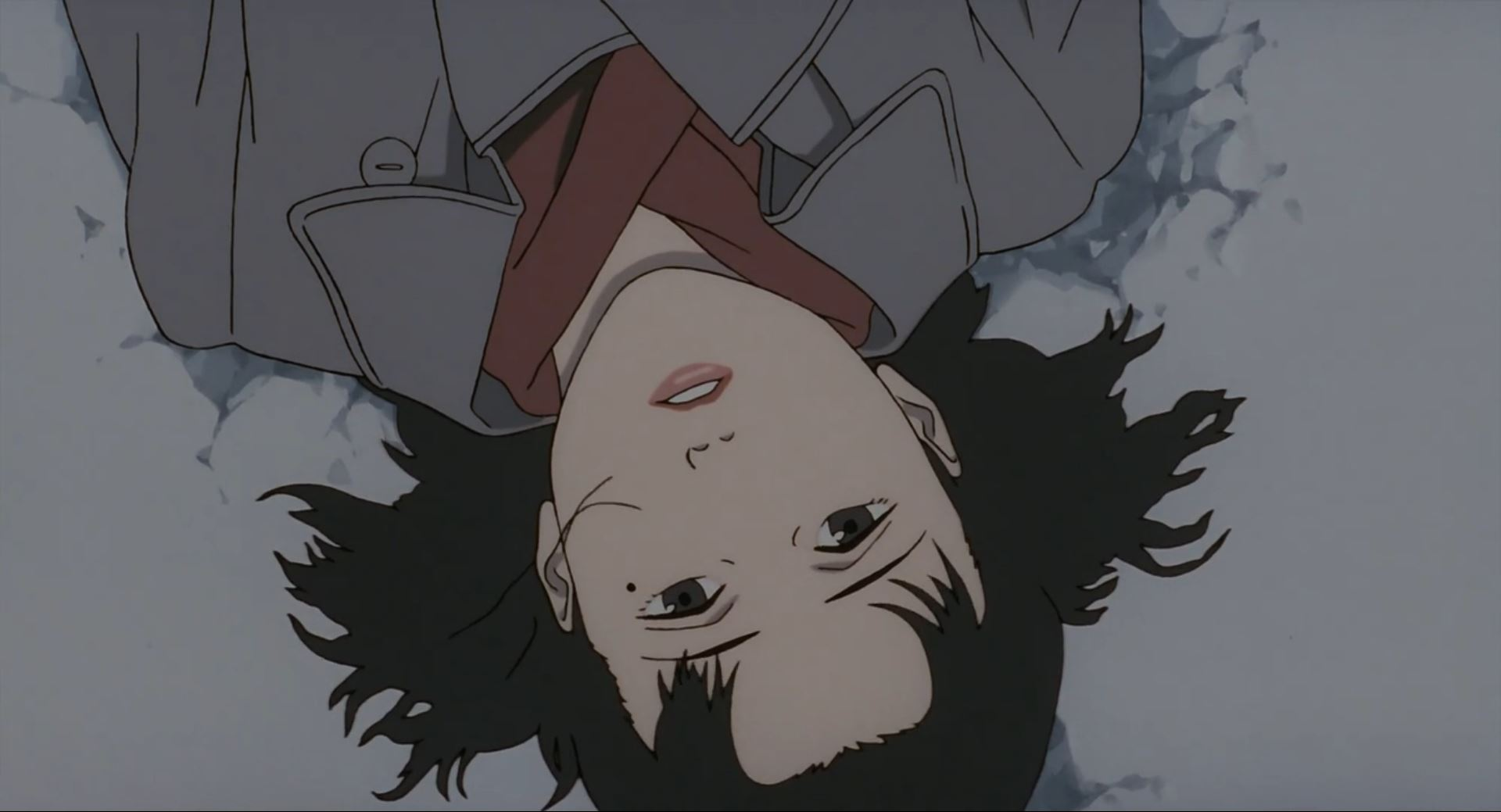 A middle-aged Chiyoko lying down face-up in the snow.