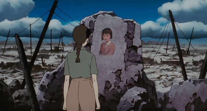 Chiyoko, as a young woman, staring at the bombed out rubble of her house, where a painting of her as a teenager is still affixed to the wall.