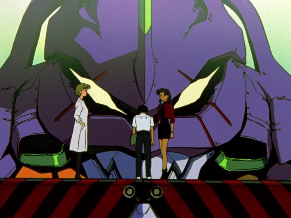Shinji standing in front of Evangelion Unit 01, his shoulders hunched, while Misato and Ritsuko look on, exasperated.