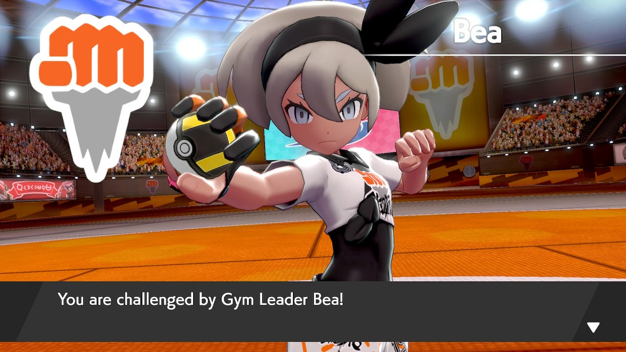 Fighting-type gym leader Bea challenges you to a battle. she has dark skin and gray hair.