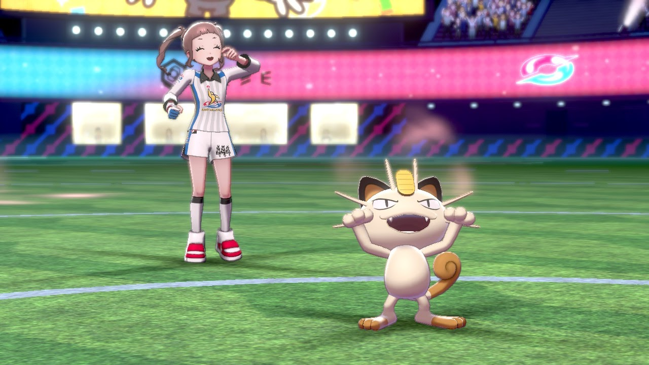 A female trainer in a stadium with a Meowth.