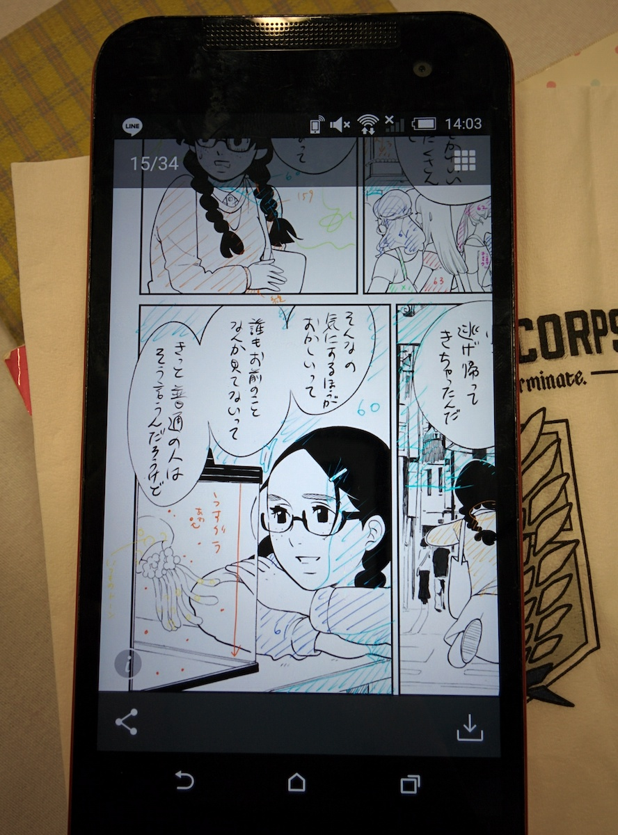 A cell phone with rough manga drawings. There are lots of colored lines