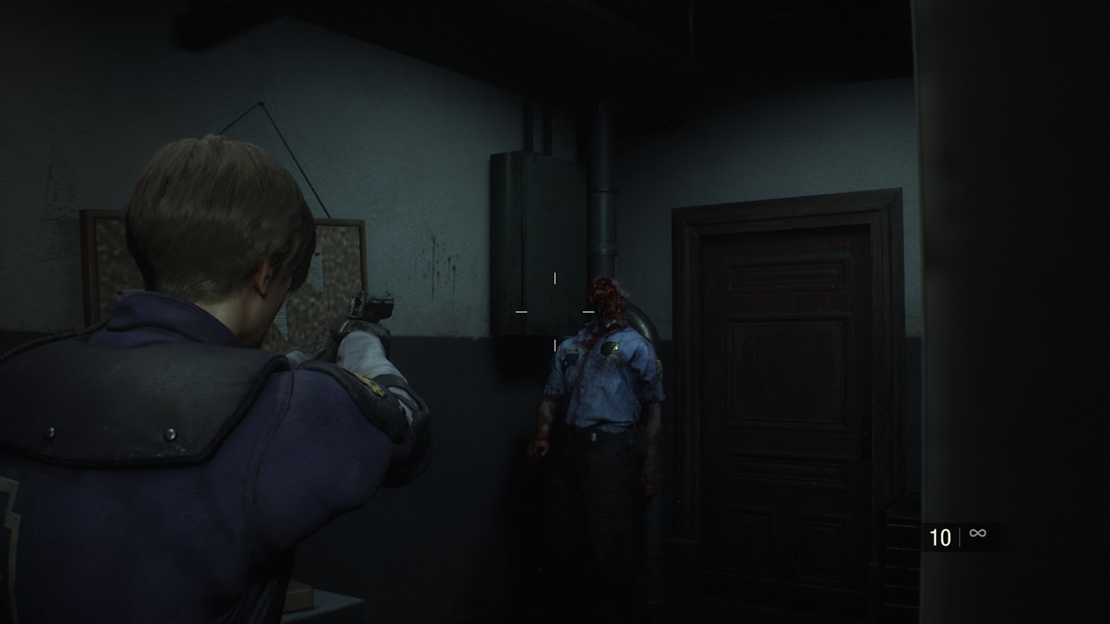 Leon from Resident Evil 2 Remake pointing his pistol at a zombie in a dark room.