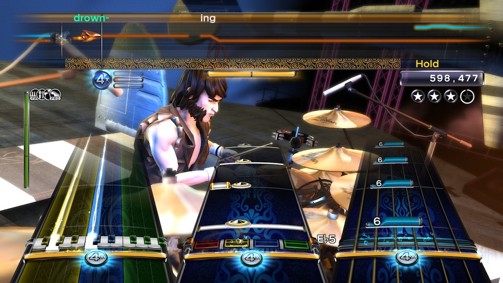 A song being played in Rock Band 3 with all four instruments: bass, drums, guitar, and vocals.