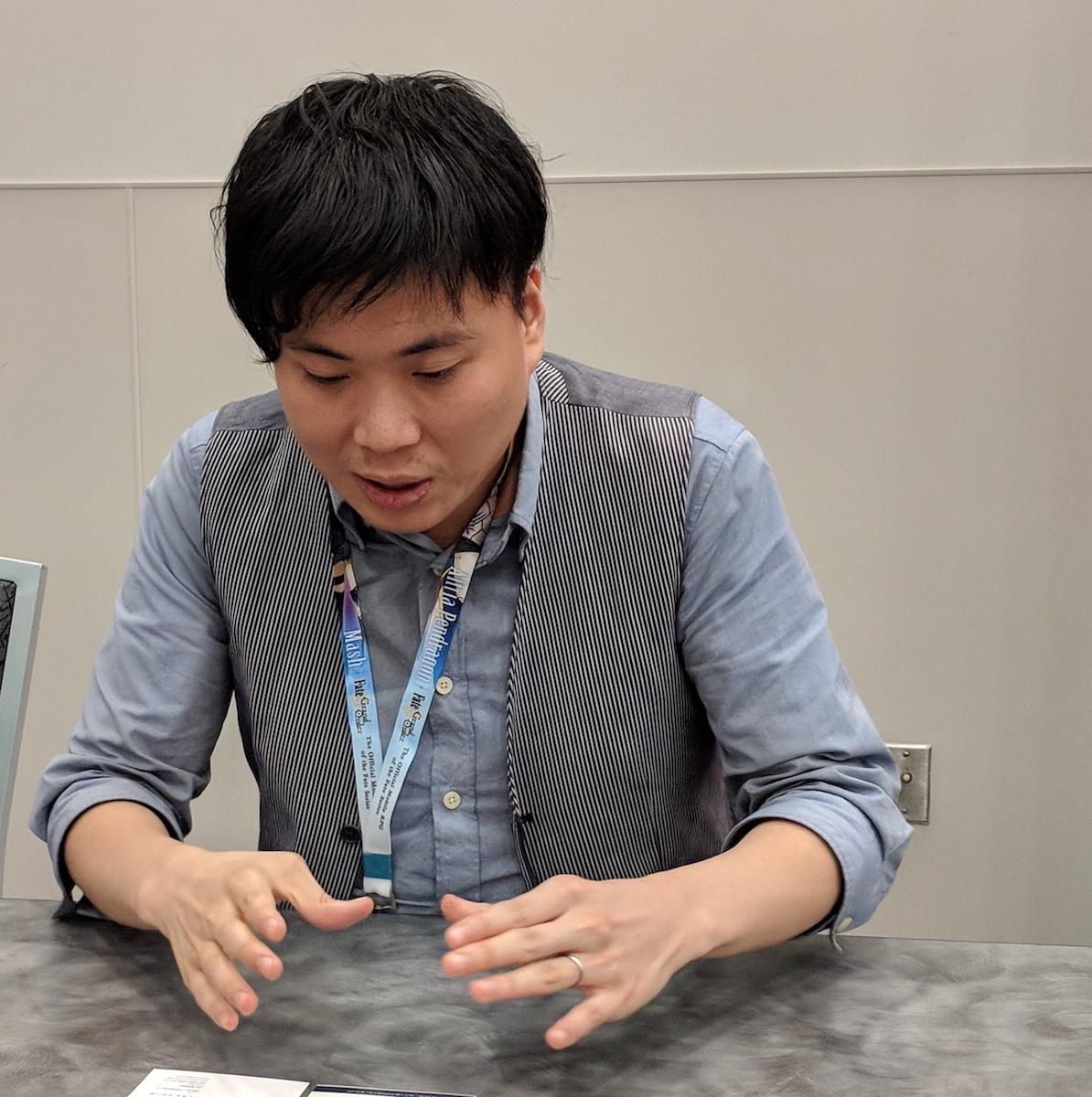 Shingo Yamashita gesturing with his hands while speaking