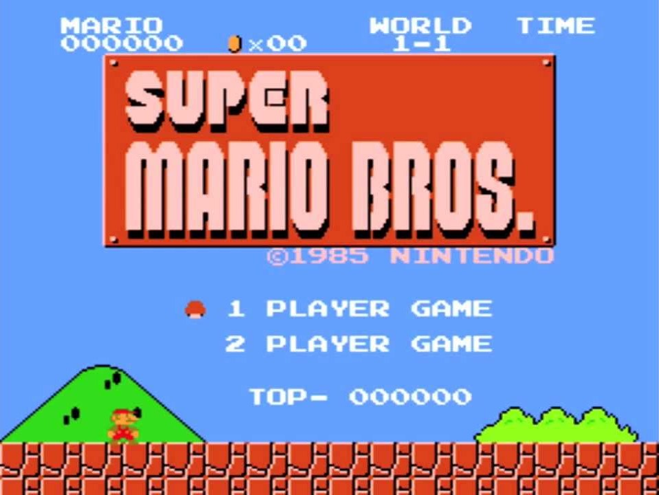 Title screen of Super Mario Bros. Mario is standing on the ground with mountains behind him.