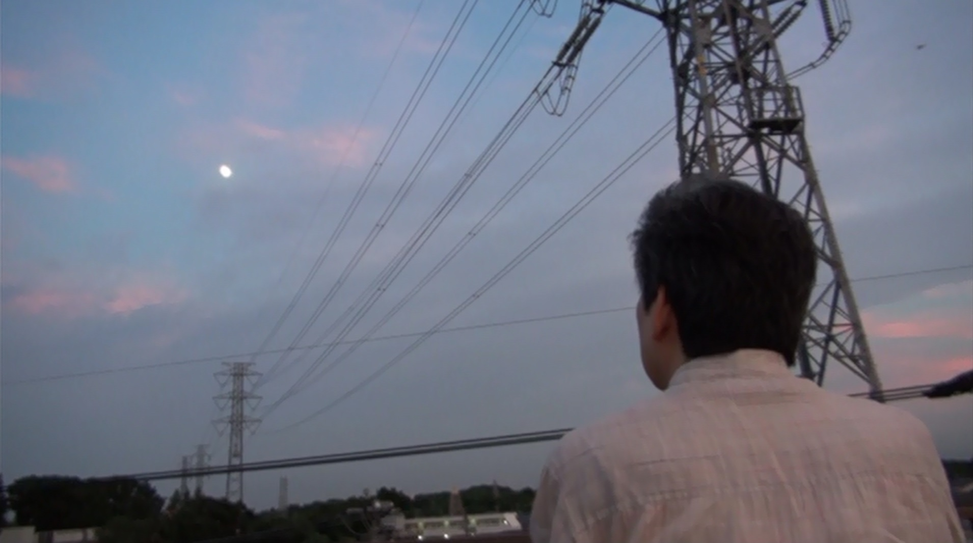Isao Takahata stares at the moon from the rooftop of Studio Ghibli 7.