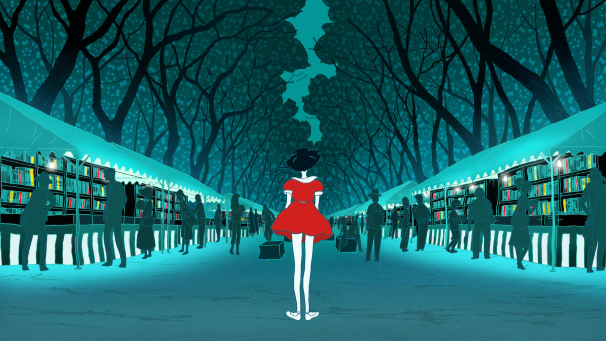 The girl in the red dress from The Night Is Short, Walk on Girl standing in front of rows of books at an outdoor market