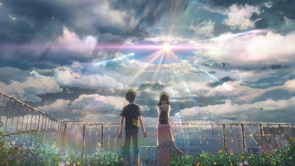 Hodaka and Hina looking up at the sky. The sun is parting the clouds.