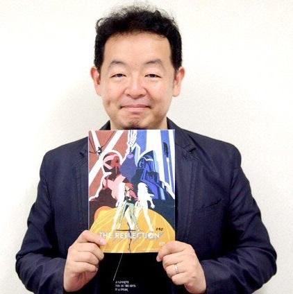 Hiroshi Nagahama holding The Reflection key art via Otakon